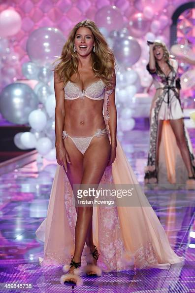 Model Doutzen Kroes wears Victoria's Secret Dream Angels Embellished Plunge Bra and Matching Panty Hand Embellished Silk Chiffon Gown with Swarovski...