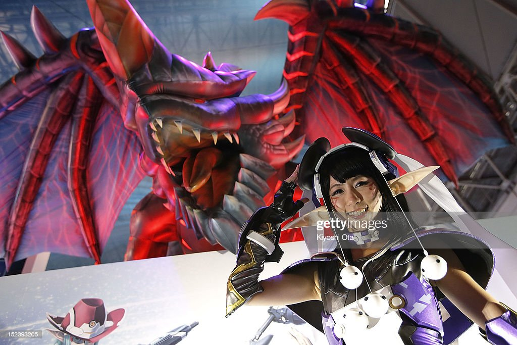 A model dressed as a character from Sega Corp.'s 'Phantasy Star Online 2' poses at the company's booth during the Tokyo Game Show 2012 at Makuhari Messe on September 20, 2012 in Chiba, Japan. The annual video game expo, which is held from September 20 to 23, attracts thousands of business visitors and the general public with exhibitions of the upcoming game software and latest hardware.