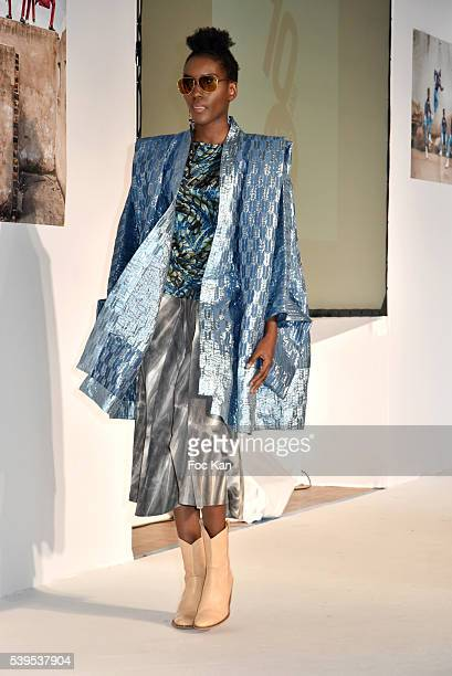 A model dressed by Alex Rotin walks the runway during 'Labo International' 10th Edition African Ethnic and Sapeurs Fashion Show at Espace des Blancs...