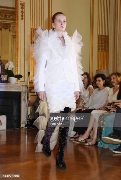 A model dressed by Bata Spasojevic walks the runway during La Journee De La Mode Serbe at Ambassade de Serbie on July 13 2017 in Paris France