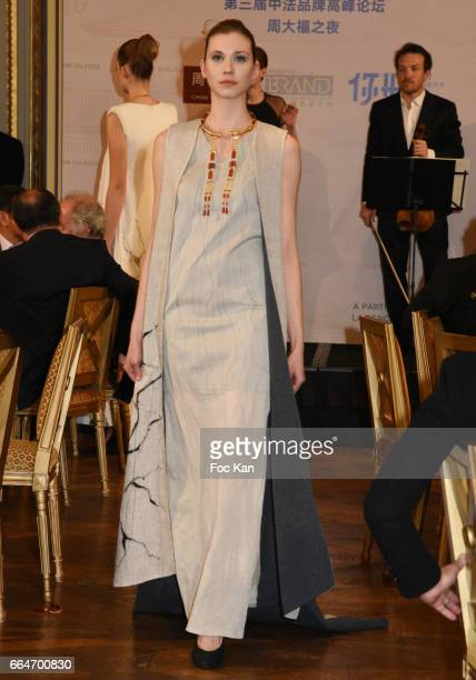 A model dressed by ESMOD stylists and bearing Chow Tai Fook jewellery walks the runway during the Chow Tai Fook Jewellry Show Hosted by Bonjour Brand...