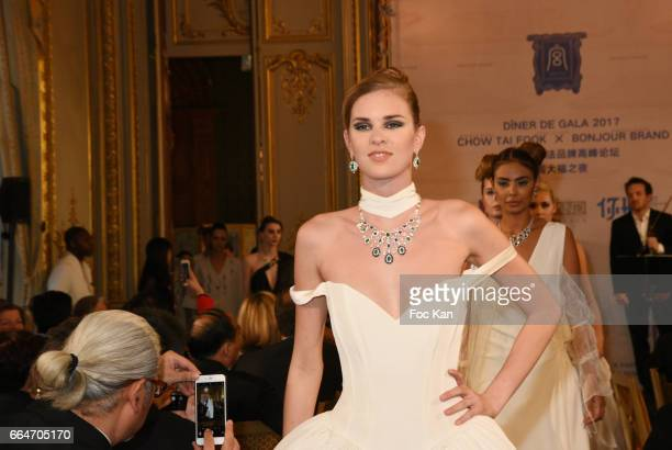 Model dressed by ESMOD stylists and bearing Chow Tai Fook jewellery walks the runway during the Chow Tai Fook Jewellry Show Hosted by Bonjour Brand...