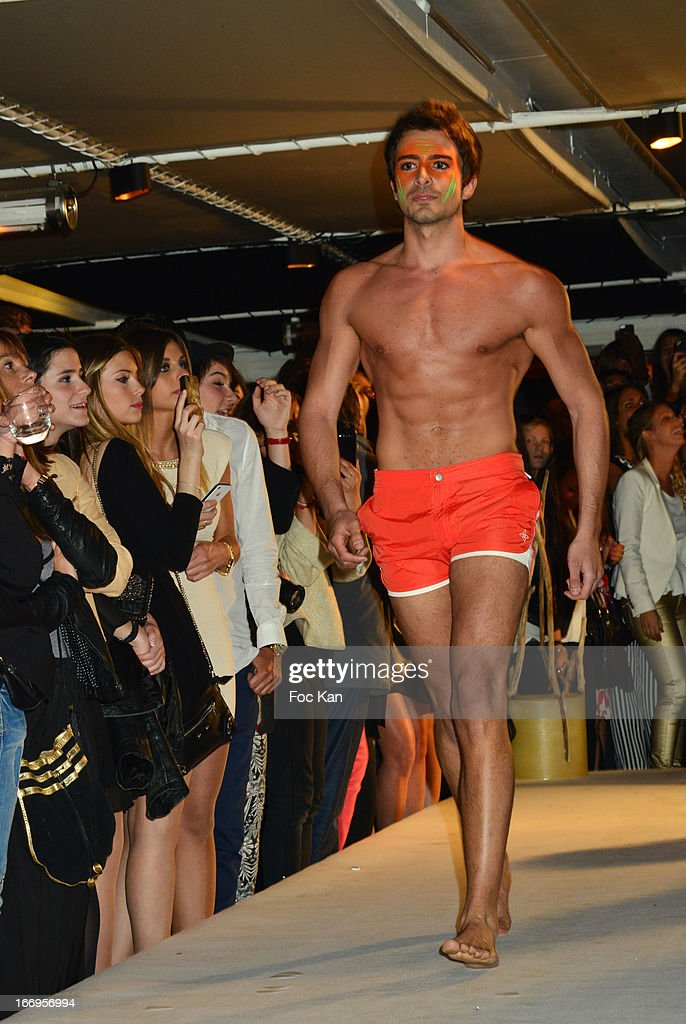 A model dressed by Le Cap Swimming Suits walks the runway during 'Le Salon Sur L'Eau Marrezziani And Le Cap Swimming Suits' Show Cocktail At Quai Marcel Dassault on April 18, 2013 in Suresnes, France.