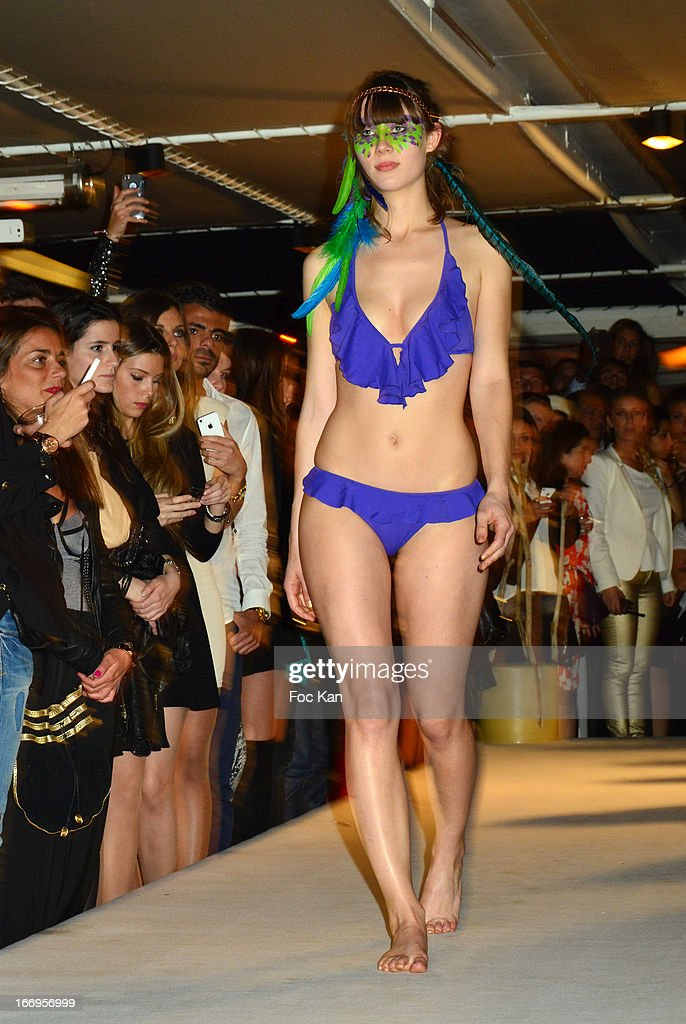 A model dressed by Marrezziani Swimming Suits walks the runway during 'Le Salon Sur L'Eau Marrezziani And Le Cap Swimming Suits' Show Cocktail At Quai Marcel Dassault on April 18, 2013 in Suresnes, France.