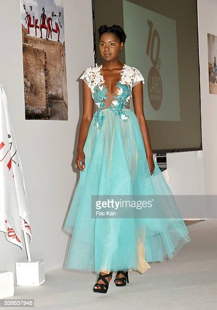 A model dressed by Tina Lobondi walks the runway during 'Labo International' 10th Edition African Ethnic and Sapeurs Fashion Show at Espace des...