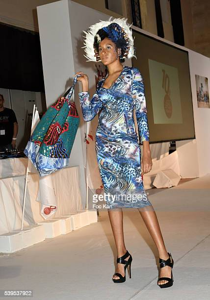A model dressed by Xuly Bet walks the runway during 'Labo International' 10th Edition African Ethnic and Sapeurs Fashion Show at Espace des Blancs...
