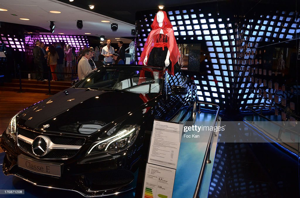 A model dressed by Zelia Van den Bulke is exhibited in a Mercedes car during the 'Feerique Gallery' Zelia Van Den Bulke Exhibition At Espace Mercedes Champs Elysees on June 11, 2013 in Paris, France.