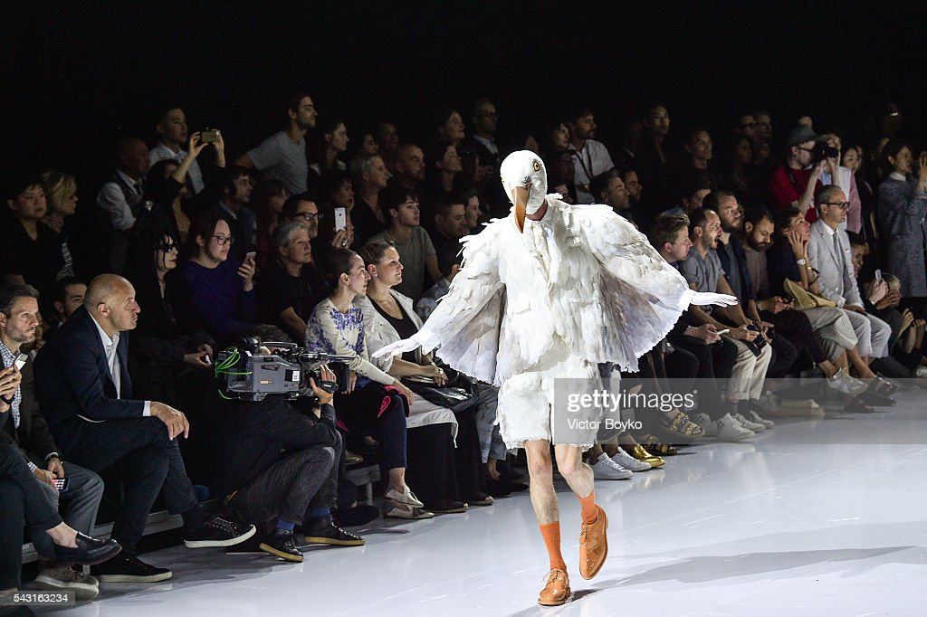 A model dressed in a bird outfit walks the runway during the Thom Browne Menswear Spring/Summer 2017 show as part of Paris Fashion Week on June 26, 2016 in Paris, France.