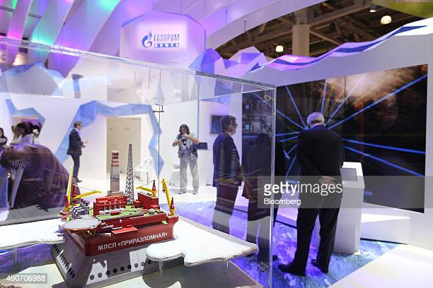 A model drilling platform stands on display at the OAO Gazprom corporate pavilion during the 21st World Petroleum Congress in Moscow Russia on Monday...