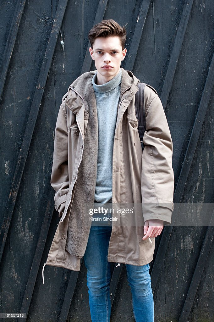 Model <a gi-track='captionPersonalityLinkClicked' href=/galleries/search?phrase=Dylan+Jones&family=editorial&specificpeople=712578 ng-click='$event.stopPropagation()'>Dylan Jones</a> wears Topman jeans, Next top and a Camden market coat day 3 of London Mens Fashion Week Autumn/Winter 2014, on January 08, 2014 in London, England.