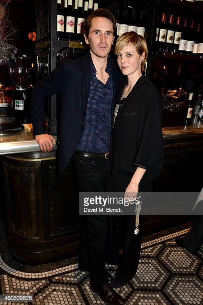 Model Edie Campbell and Otis Ferry attend the LOVE x Balmain Xmas Party at The Ivy Market Grill on December 15 2014 in London England