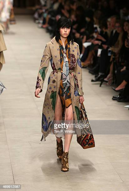 Model Edie Campbell walks the runway at the Burberry Prorsum show at London Fashion Week AW14 at Perks Fields Kensington Gardens on February 17 2014...