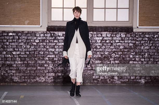 Model Edie Campbell walks the runway during the John Galliano show as part of the Paris Fashion Week Womenswear Fall/Winter 2016/2017 on March 6 2016...
