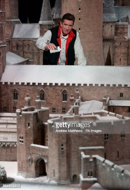Model Effects Supervisor Jose Granell adds some of the last sprinkles of snow to the model of Hogwarts School at Warner Bros Studio Tour London The...