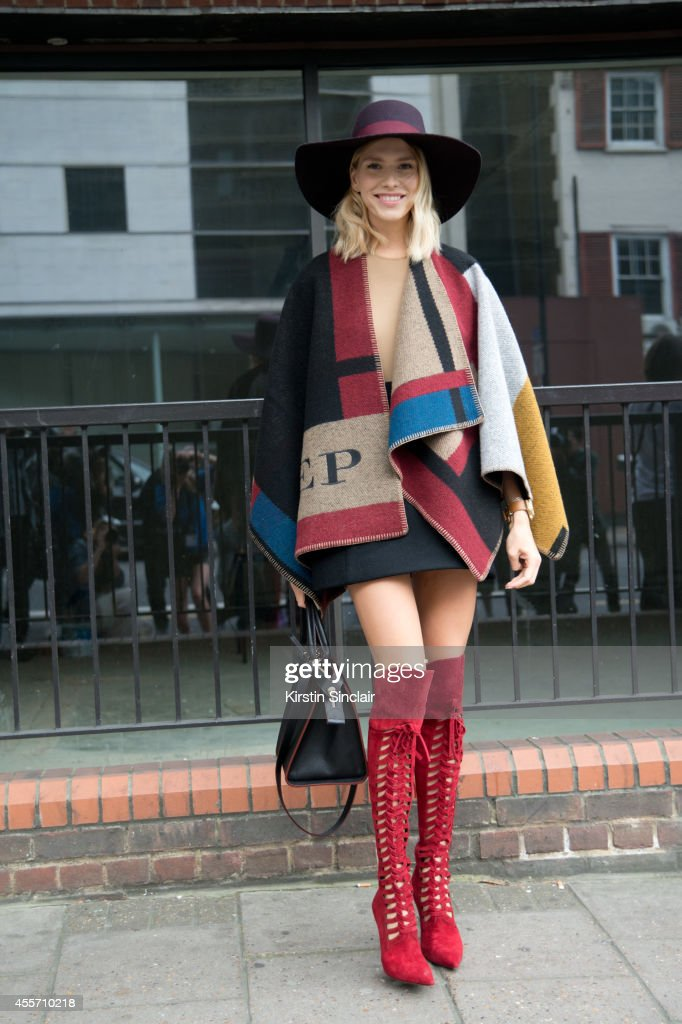 Model Elena Perminova is wearing a Burberry coat and Versace boots on day 3 of London Collections: Women on September 14, 2014 in London, England.