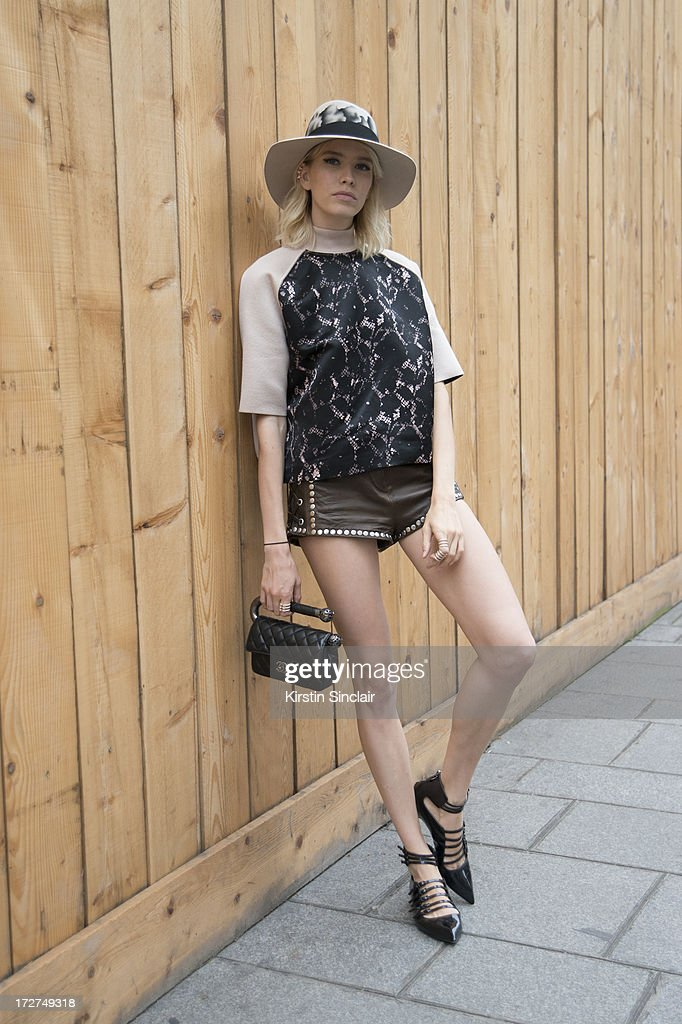 Model <a gi-track='captionPersonalityLinkClicked' href=/galleries/search?phrase=Elena+Perminova&family=editorial&specificpeople=6479553 ng-click='$event.stopPropagation()'>Elena Perminova</a> wears a Louis Vuitton top, H and M shorts, Casadei shoes, Chanel bag and a Maison Michel hat on day 4 of Paris Collections: Womens Haute Couture on July 04, 2013 in Paris, France.