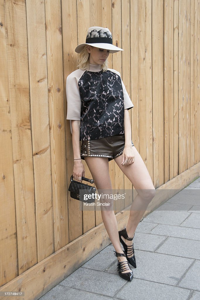 Model Elena Perminova wears a Louis Vuitton top, H and M shorts, Casadei shoes, Chanel bag and a Maison Michel hat on day 4 of Paris Collections: Womens Haute Couture on July 04, 2013 in Paris, France.