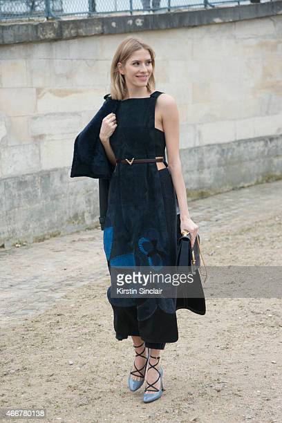 Model Elena Perminova wears a Valentino dress jacket bag and shoes and Mugler top on day 8 of Paris Collections Women on March 10 2015 in Paris France