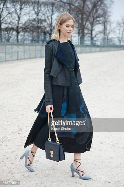 Model Elena Perminova wears a Valentino dress shoes bag and jacket on day 8 of Paris Collections Women on March 10 2015 in Paris France
