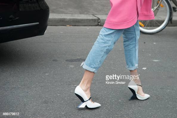 Model Elena Perminova wears an Emillio Pucci coat and Christian Dior shoes on day 7 of Paris Collections Women on March 09 2015 in Paris France