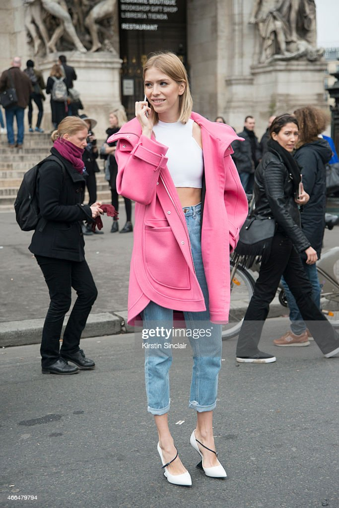 Model Elena Perminova wears an Emillio Pucci coat Christian Dior shoes and Versace top on day 7 of Paris Collections Women on March 09 2015 in Paris...