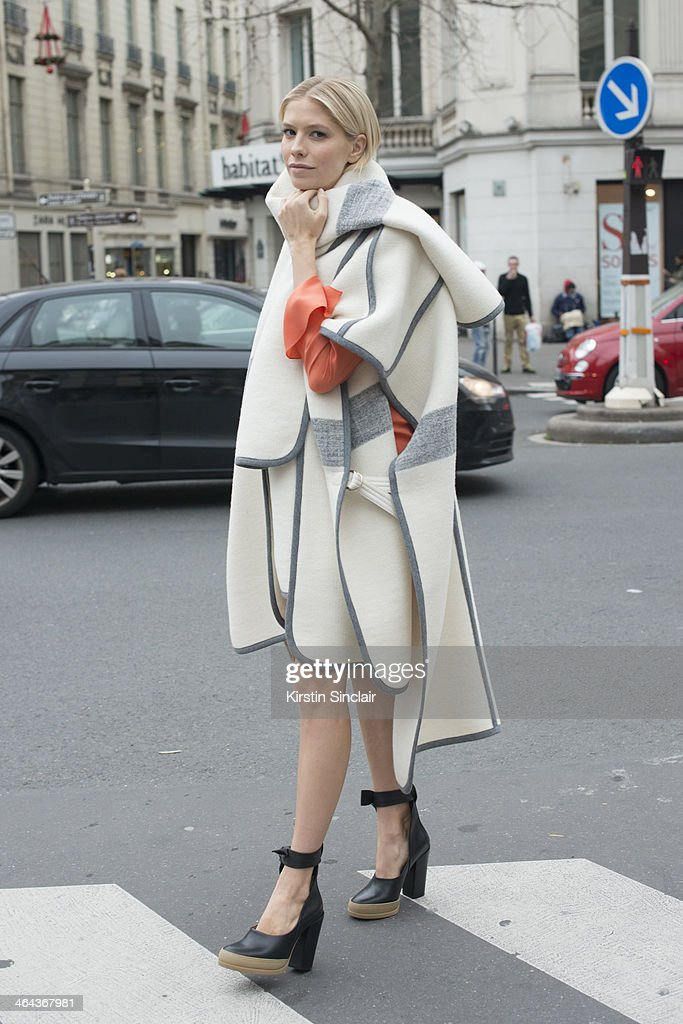 Model <a gi-track='captionPersonalityLinkClicked' href=/galleries/search?phrase=Elena+Perminova&family=editorial&specificpeople=6479553 ng-click='$event.stopPropagation()'>Elena Perminova</a> wears Chloe shoes, dress and jacket day 2 of Paris Haute Couture Fashion Week Spring/Summer 2014, on January 21, 2014 in Paris, France.