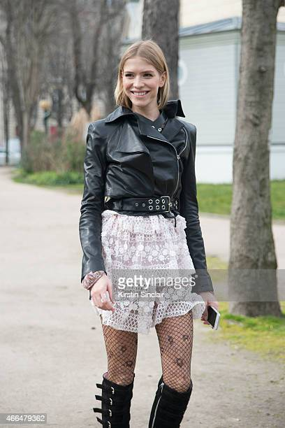 Model Elina Perminova wears all Giamba and a Mugler jacket on day 7 of Paris Collections Women on March 09 2015 in Paris France