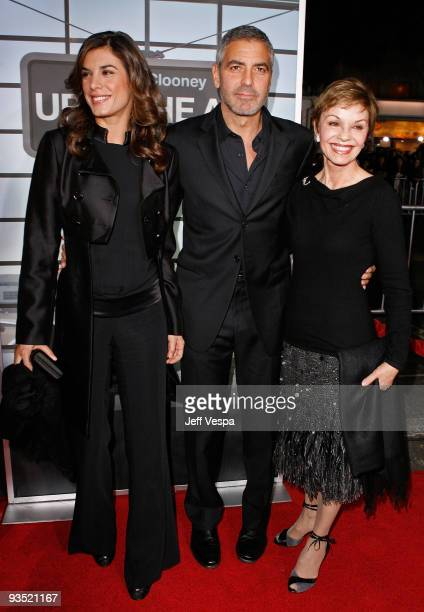 Model Elisabetta Canalis actor George Clooney and his mother Nina Warren arrive at the Los Angeles premiere of 'Up In The Air' at Mann Village...