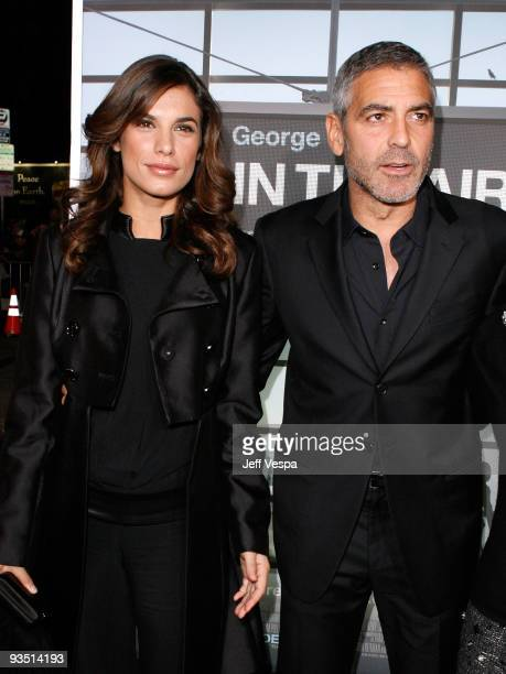 Model Elisabetta Canalis and actor George Clooney arrive at the Los Angeles premiere of 'Up In The Air' at Mann Village Theatre on November 30 2009...