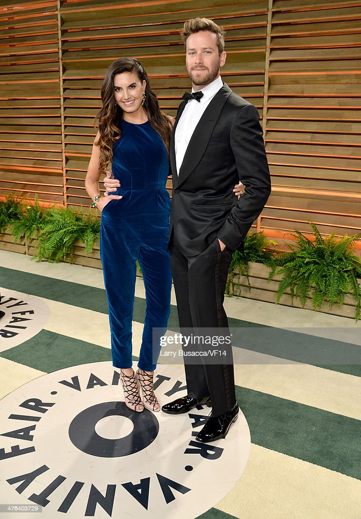 Model <a gi-track='captionPersonalityLinkClicked' href=/galleries/search?phrase=Elizabeth+Chambers&family=editorial&specificpeople=5295153 ng-click='$event.stopPropagation()'>Elizabeth Chambers</a> (L) and actor <a gi-track='captionPersonalityLinkClicked' href=/galleries/search?phrase=Armie+Hammer&family=editorial&specificpeople=5313113 ng-click='$event.stopPropagation()'>Armie Hammer</a> attend the 2014 Vanity Fair Oscar Party Hosted By Graydon Carter on March 2, 2014 in West Hollywood, California.