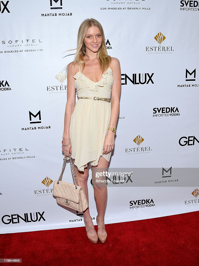 Model <a gi-track='captionPersonalityLinkClicked' href=/galleries/search?phrase=Elle+Evans&family=editorial&specificpeople=10058727 ng-click='$event.stopPropagation()'>Elle Evans</a> arrives at the Genlux Magazine release party with Erika Christensen at Sofitel Hotel on August 29, 2013 in Los Angeles, California.