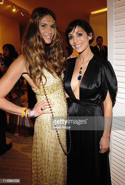 Model Elle MacPherson wearing a selection of yellow gold Chopard Jewellery and Natalie Imbruglia wearing a pendant composed of a 2359ct spinel...