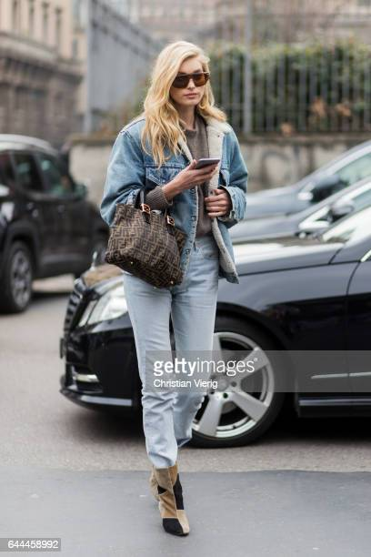 Model Elsa Hosk wearing denim jacket denim jeans outside Max Mara during Milan Fashion Week Fall/Winter 2017/18 on February 23 2017 in Milan Italy