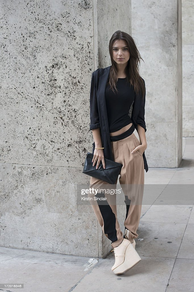 Model Emiley Ratajkowski wears Chloe trousers, Rick Owens vest, Wendy Nicholls jacket, M.A Cross bag and Etscallatay shoes on day 3 of Paris Collections: Men on June 28, 2013 in Paris, France.