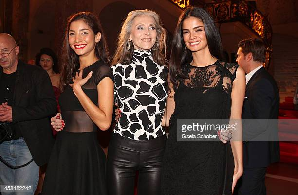 Model Emilie Payet Model Eveline Hall Model Shermine Shahrivar attend the presentation of the Lambertz 'Paris' calendar 2015 at Bode Museum on...