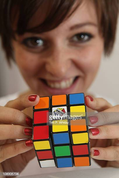 Model Emily Dixon playing wth the classic Rubiks Cube at the Toy Fair 2011 at Olympia Exhibition Centre on January 25 2011 in London England