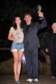 Model Emily Ratajkowski and Fabio Testi attend the Day 1 of Ischia Global Film Music Fest 2014 on July 12 2014 in Ischia Italy