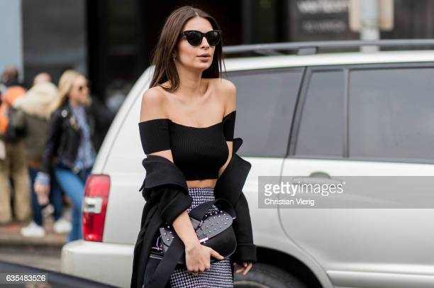 Model Emily Ratajkowski wearing a cropped top pencil skirt outside Michael Kors on February 15 2017 in New York City