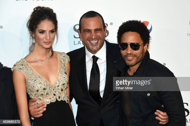 Model Emina Cunmulaj Founder Chairman and CEO of sbe Sam Nazarian and recording artist Lenny Kravitz attend the SLS Las Vegas grand opening...
