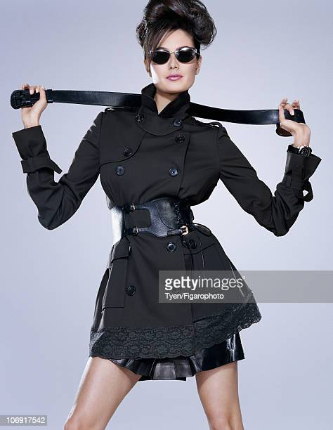 Model Emma Heming poses for Madame Figaro in Paris on June 15 2010 Published image Trench skirt glasses and watch by Dior trench belt by Sergio Rossi...