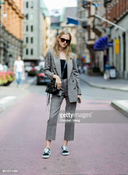 Model Emma Stalhammar wearing a Balenciaga bag grey suit outside Busnel on August 30 2017 in Stockholm Sweden