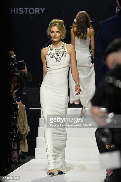 Model Eniko Mihalik walks during the fashion show runway during amfAR's 22nd Cinema Against AIDS Gala Presented By Bold Films And Harry Winston at...
