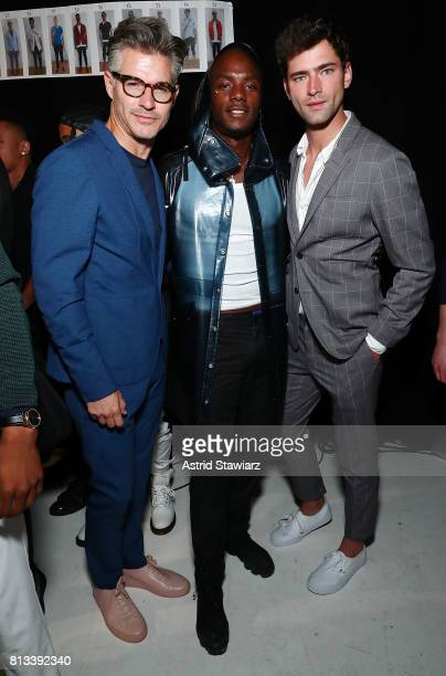 Model Eric Rutherford rapper Young Paris and model Sean O'Pry pose for photos backstage at the EFM Engineered For Motion Spring/Summer 2018 Runway...