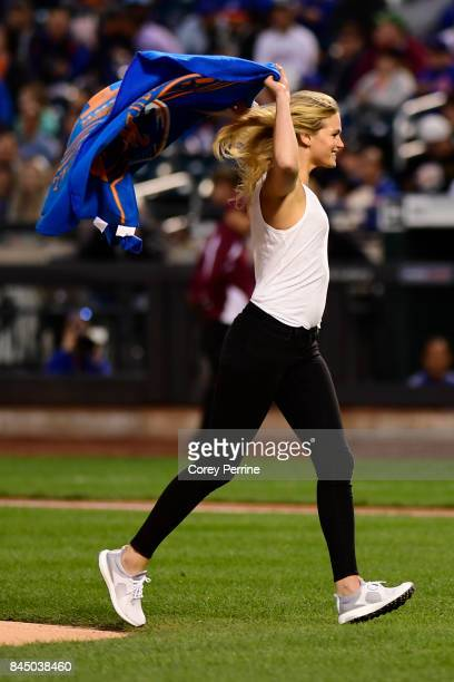 Model Erin Heatherton reacts after throwing out the ceremonial first pitch as the New York Mets host the Cincinnati Reds at Citi Field on September 9...