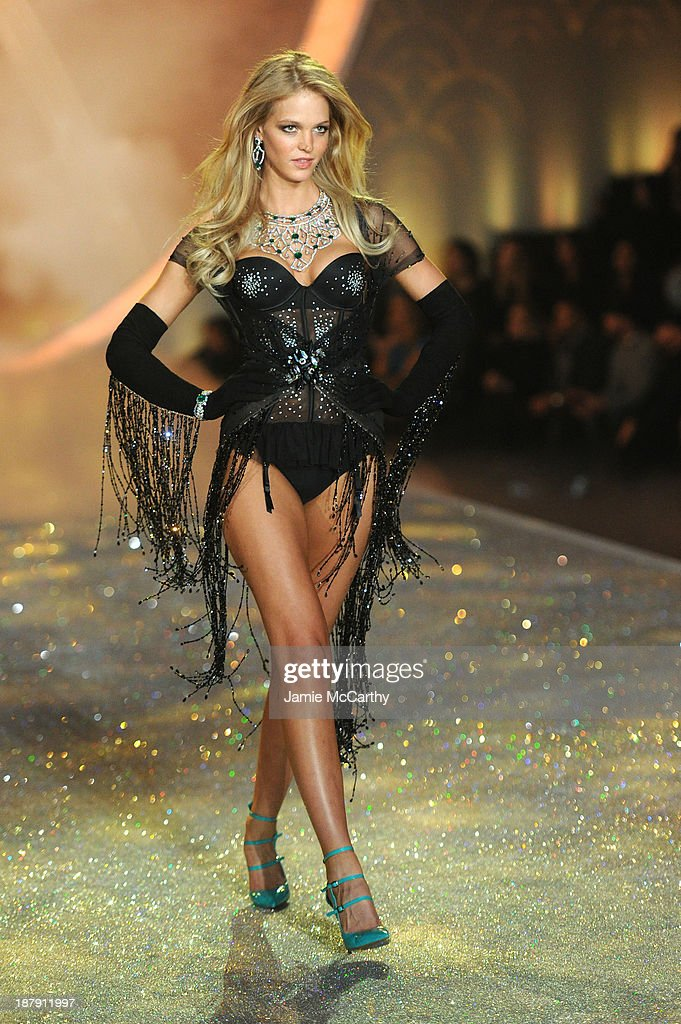 Model <a gi-track='captionPersonalityLinkClicked' href=/galleries/search?phrase=Erin+Heatherton&family=editorial&specificpeople=5003810 ng-click='$event.stopPropagation()'>Erin Heatherton</a> walks the runway at the 2013 Victoria's Secret Fashion Show at Lexington Avenue Armory on November 13, 2013 in New York City.