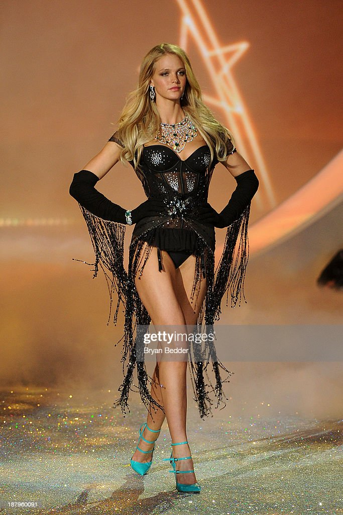 Model Erin Heatherton walks the runway wearing Skirt with Swarovski Crystalsat the 2013 Victoria's Secret Fashion Show at Lexington Avenue Armory on November 13, 2013 in New York City.
