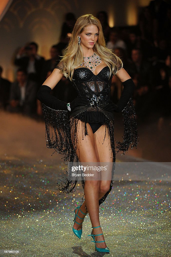 Model Erin Heatherton walks the runway wearing Skirt with Swarovski Crystalsat the 2013 Victoria's Secret Fashion Show at Lexington Avenue Armory on November 13, 2013 in New York City.