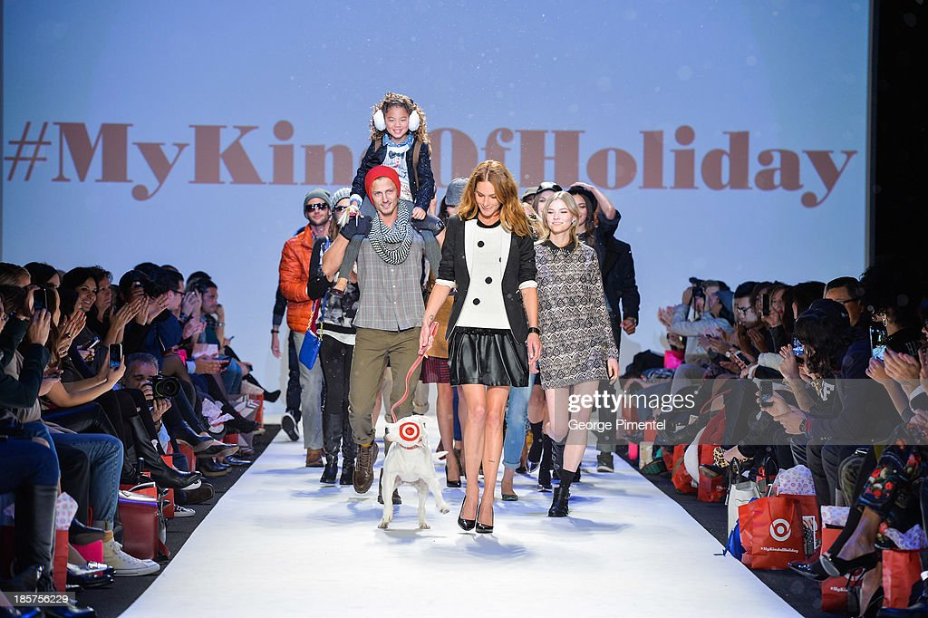 Model <a gi-track='captionPersonalityLinkClicked' href=/galleries/search?phrase=Erin+Wasson&family=editorial&specificpeople=592102 ng-click='$event.stopPropagation()'>Erin Wasson</a> and Bullseye walk the runway during Target spring 2014 collectiono during World MasterCard Fashion Week Spring 2014 at David Pecaut Square on October 24, 2013 in Toronto, Canada.