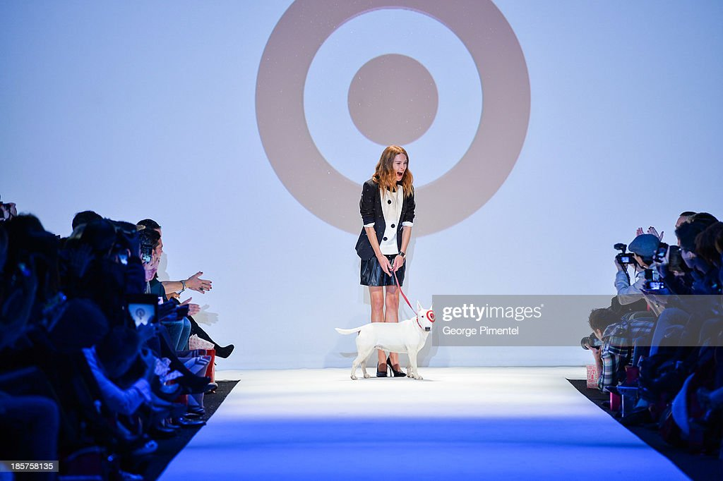 Model <a gi-track='captionPersonalityLinkClicked' href=/galleries/search?phrase=Erin+Wasson&family=editorial&specificpeople=592102 ng-click='$event.stopPropagation()'>Erin Wasson</a> and Bullseye walk the runway during Target spring 2014 collection during World MasterCard Fashion Week Spring 2014 at David Pecaut Square on October 24, 2013 in Toronto, Canada.
