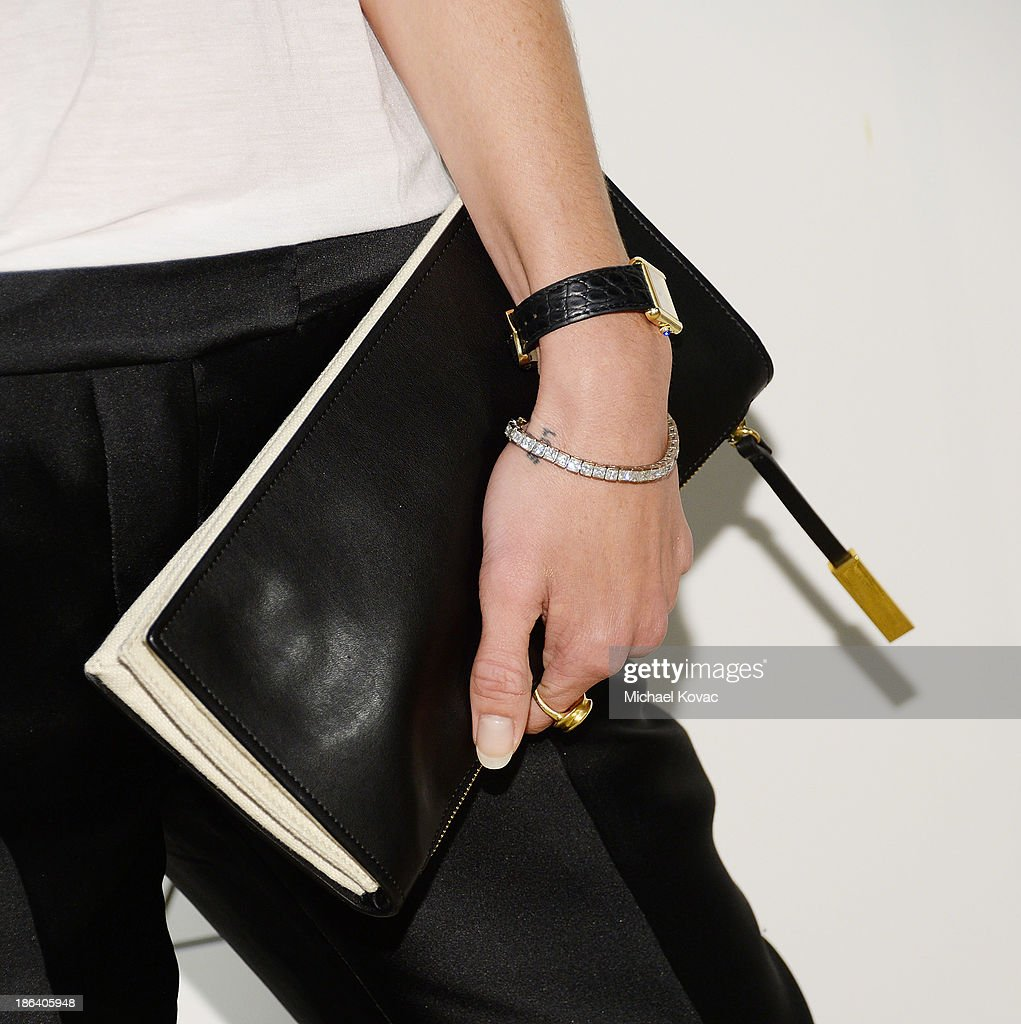 Model Erin Wasson (handbag detail) arrives at the Fourth Annual Autumn Party With Stella McCartney on October 30, 2013 in Los Angeles, California.